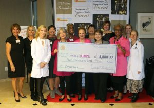 Skin Cancer Specialists presenting 10 Women of Hope with check